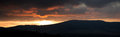 Panorama Sunset Over The Mountains To The Overcast Sky Stock Images - 65170084