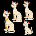 Four Egyptian Figurines Of White Cats Stock Photo - 65170770