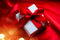 Valentine Gift Box On Red Silk Background Royalty Free Stock Photos - 65174468