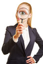 Eye Of Businesswoman Through Magnifying Glass Royalty Free Stock Photo - 65190215