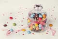 Colorful Candy Jar Decorated With Bow Ribbon On White Background With Confetti Stock Photography - 65215932
