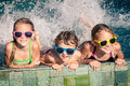 Happy Children  Playing On The Swimming Pool At The Day Time Royalty Free Stock Photos - 65219848