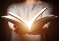 Light Coming From Book In Woman S Hands In Gesture Of Giving Stock Photos - 65235943
