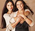 Cute Pretty Teen Daughter With Mature Mother Stock Images - 65248944