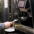 Man Going To Prerare Coffee Maker Stock Photography - 65289772