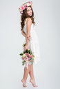 Beautiful Woman In White Dress And Roses Wreath Standing Barefoot Stock Image - 65296581