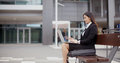 Side View Of Woman Alone With Laptop On Bench Royalty Free Stock Images - 65299409