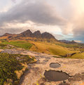 Rock Pools, Peaks And Clouds Stock Image - 65301821