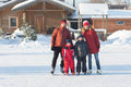 Happy Family Skate In The Winter Stock Photography - 65303442