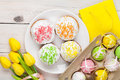 Easter With Yellow Tulips, Colorful Eggs And Traditional Cakes Royalty Free Stock Photography - 65309377
