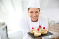 Smiling Pastry Chef With Deserts Royalty Free Stock Photo - 65338705
