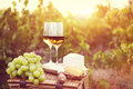 Various Sorts Of Cheese And Two Glasses Of White Wine Royalty Free Stock Photos - 65347838