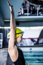 Side View Of A Woman Swimmer Ready To Dive Stock Photo - 65351760