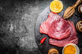 Raw Tuna Fish Steaks With Ingredients For Grill Or Cooking On Dark Vintage Background, Top View Stock Photography - 65359312