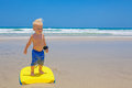 Little Child Swimming With Bodyboard On The Sea Sand Beach Stock Photo - 65364910
