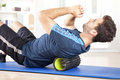 Man Lying On A Foam Roller While Doing An Exercise Royalty Free Stock Photos - 65371668