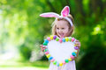 Little Girl With White Board For Easter Greetings Royalty Free Stock Images - 65377819