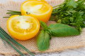 Yellow Tomato With Green Parsley And Basil On Jute Canvas In Garden On Sunny Day Royalty Free Stock Image - 65397626