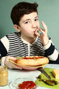 Boy With Self Made Huge Hotdog Smile Royalty Free Stock Image - 65399346