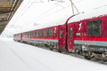 Train Of The National Railway Company (CFR) Who Arrived During A Snow Storm Stock Photo - 65416090