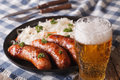 Lager Beer And Snacks Of Sausages And Sauerkraut Stock Photos - 65420463