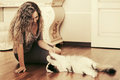 Beautiful Woman Playing With A Cat At Apartment Royalty Free Stock Photos - 65432288