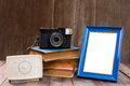Frame With Old Books And Old Camera On Wood Table Stock Photos - 65441923