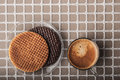 Wafers With Cup Of Coffee On The Relief Background Top View Royalty Free Stock Image - 65464486
