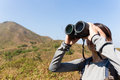 Woman Look Though Binocular When Going Hiking Royalty Free Stock Photography - 65470247