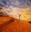 Little Girl Walking Down The Sand Dune Royalty Free Stock Photos - 65474428