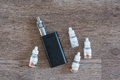 Electronic Cigarette With Liquids Close Up Stock Photography - 65491812