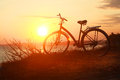 Silhouette Of A Bicycle At Sunset Royalty Free Stock Photography - 65496007