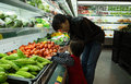 Asian People Go Shopping At A Supermarket And Choosing Fresh Fruit Stock Image - 65497011