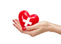 Red Heart With Cross Sign In Woman Hand, Isolated On White Stock Image - 65509601