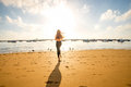 Woman Running On The Sandy Beach Royalty Free Stock Images - 65570689