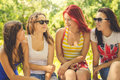 Happy Girl Friends Talking On Summer Green Royalty Free Stock Photo - 65572505
