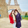 Two Girls In Paris Near The Eiffel Tower Royalty Free Stock Image - 65576206