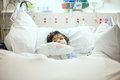 Disabled Little Boy Lying Sick In Hospital Bed Stock Photos - 65589733