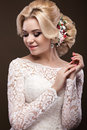 Beautiful Blond Girl  In Image Of The Bride With Purple Flowers On Her Head. Beauty Face Stock Photos - 65598613