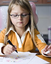 Young Girl Drawing Pictures Stock Image - 6566801