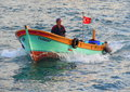 Turkish Fisherman In Small Dinghy Stock Image - 65603061