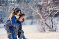 Happy Loving Couple Walking In Snowy Winter Forest, Spending Christmas Vacation Together. Outdoor Seasonal Activities. Royalty Free Stock Photography - 65603557