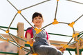 Happy Little Girl Climbing On Children Playground Royalty Free Stock Photography - 65611027