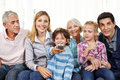 Family Watching Smart TV With Remote Control Royalty Free Stock Photo - 65624185