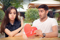 Girl Refusing Heart Shaped Gift From Her Boyfriend Royalty Free Stock Image - 65643836