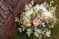 Rustic Wedding Bouquet With Roses And Succulents On Green Grass Royalty Free Stock Image - 65654376