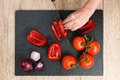 Top Down View On Cutting Board With Hands Slicing Vegetables Royalty Free Stock Photo - 65658015