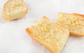 Pieces Of Garlic Bread Made With Baguette On White Paper Royalty Free Stock Image - 65669636