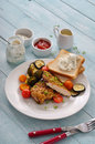 Spicy Chicken Breast On A White Plate With Grilled Vegetables Stock Photo - 65682760