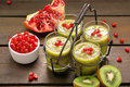 Fresh Healthy Kiwi Drink With Pomegranate In Metal Container Royalty Free Stock Images - 65686889